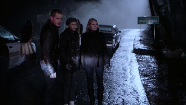 Emma, Snow and Charming notice a mysterious stranger in Storybrooke