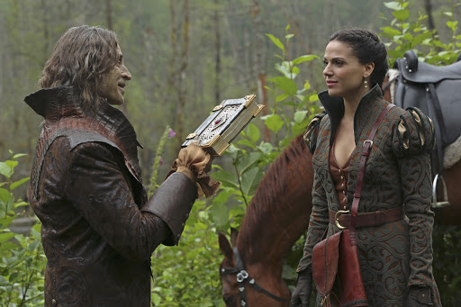 Regina and Rumple talk in the Enchanted Forest of old