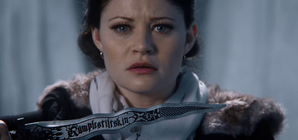 Belle holds Rumple's dagger and looks afraid