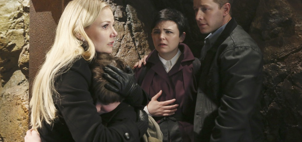 Emma and Henry embrace, while Charming and Snow look on, as they prepare for the end in the Storybrooke mines