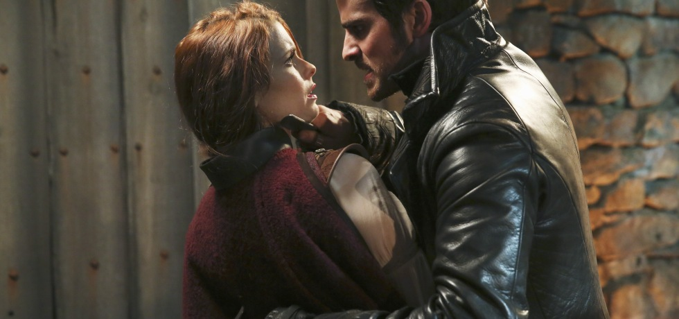 Hook threatens Ariel in the Enchanted Forest with a dagger