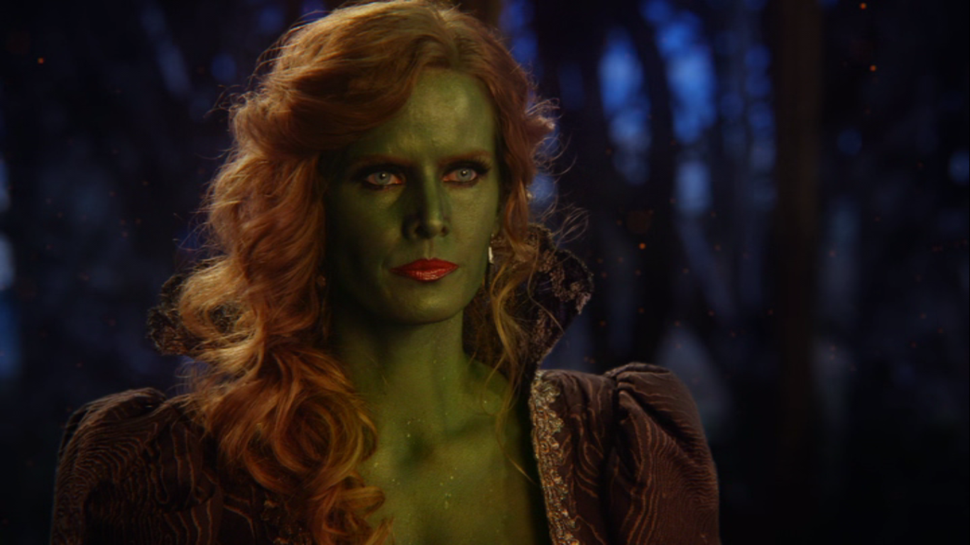 Zelena looks distrustingly at Glinda