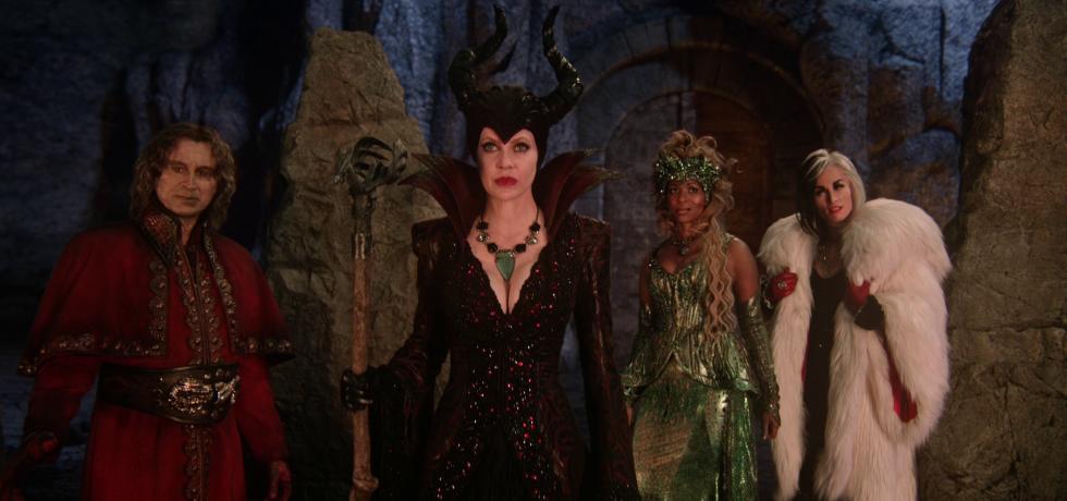 Rumple, Maleficent, Ursula and Cruella stand together
