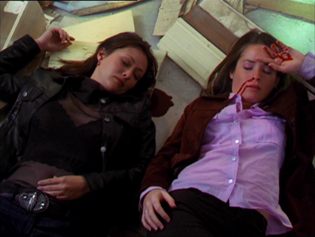 Prue and Piper lie injured on the ground