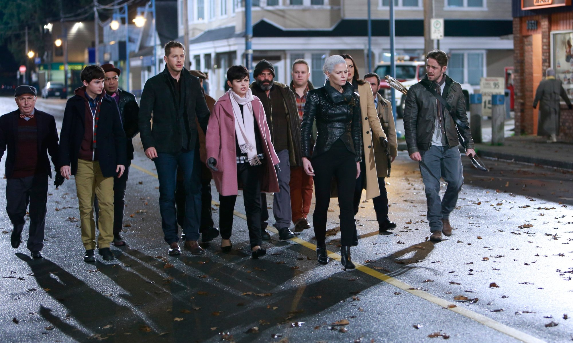 The inhabitants of Storybrooke walk through the town